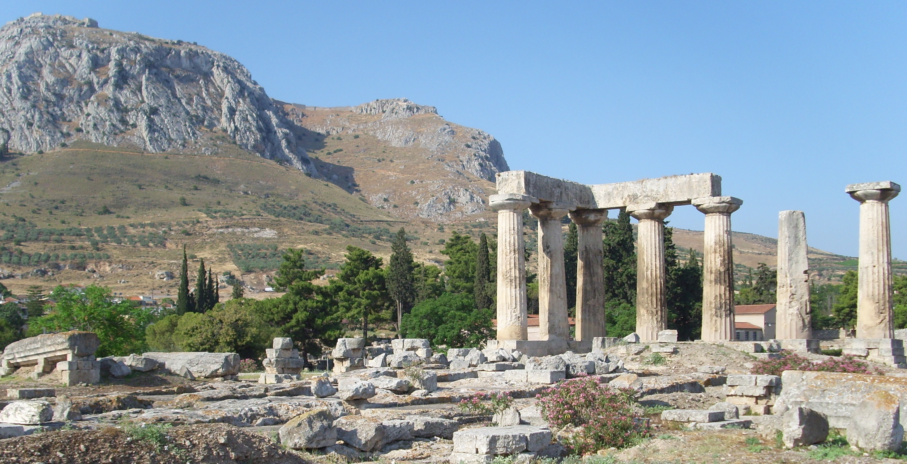 Temple of Apollo, Corinth, Greece, Acrocorinth in the background